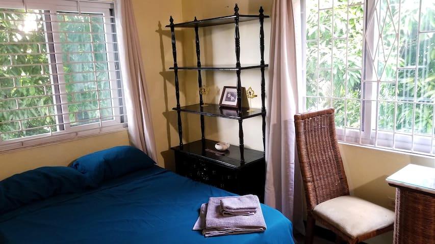 Fi Wi Yard - Mango Tree Room
