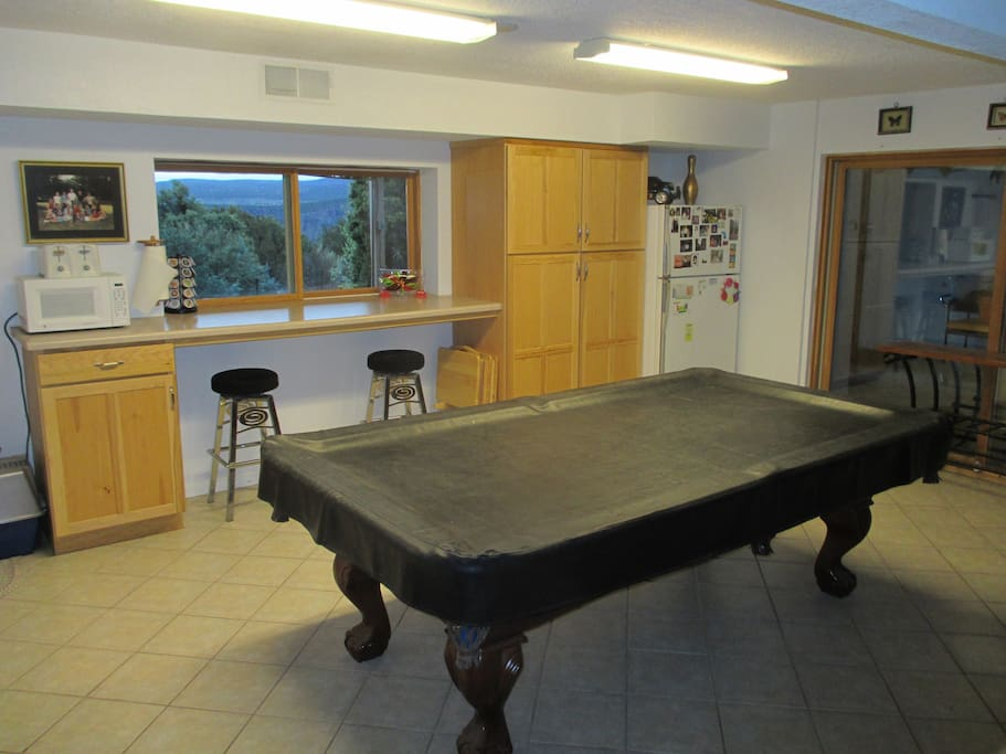 Full sized fridge, pool table, dedicated cabinet space for our guests