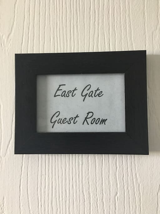 """Your door is labeled with this sign - """"East Gate Guest Room"""""""