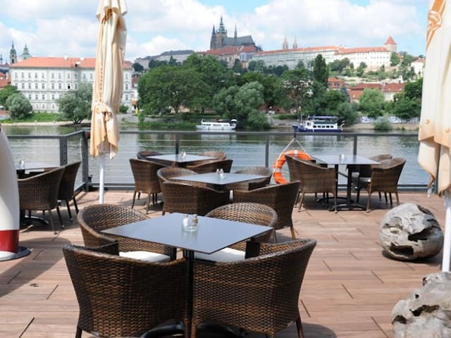 Enjoy the memorable view on the Prague Castle and Charles bridge in Marina Grosseto restaurant - only 15 min walk from the apartment