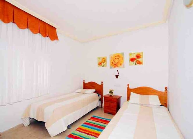 Large bright twin bedroom.