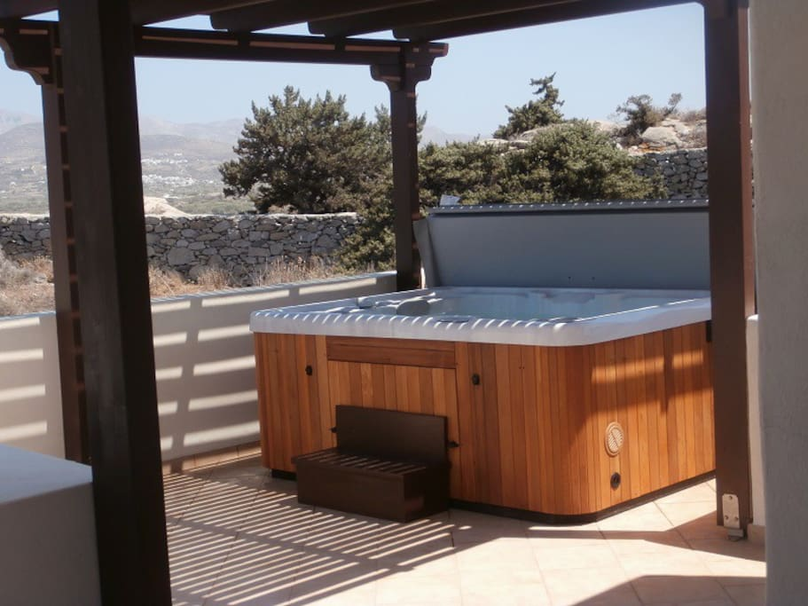 Private outdoor heated hot tub with panoramic views of the sea, Naxos Town and the surrounding area