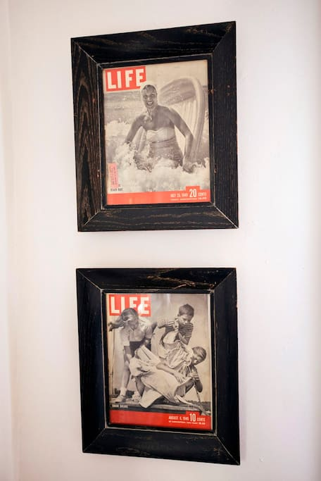 Some of the unique decorative accents include original LIFE Magazine beach covers from the 1945 and 1949! These historic images give the Master Bedroom a nostalgic glimpse of the rich history of beach living.