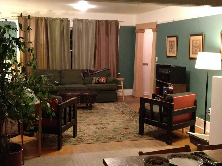 Our living room with a wood stove is ready for you to kick back and plan your next day