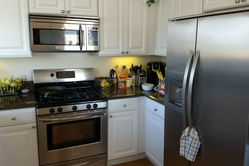 Full kitchen with gas range and all the appliances, Keurig, Coffee pot, coffee grinder, blender, food processor, mixer, toaster, microwave, dishwasher, etc.
