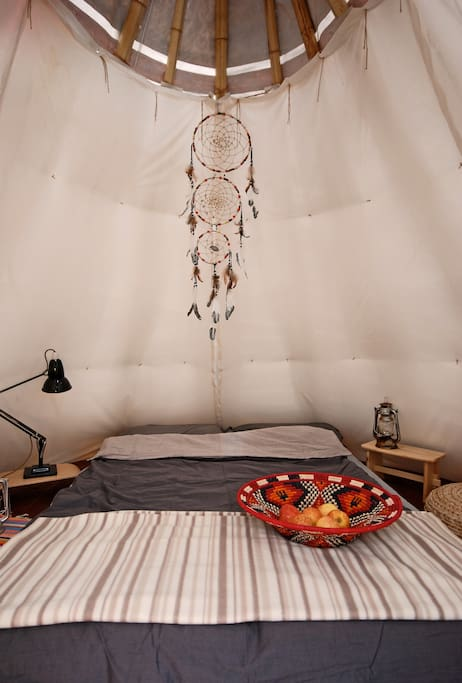 The Tipi sleeps two people on two single 'cube mattresses' that can be joined to form a double bed or folded into chairs if you want to chill out during the day.