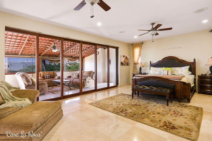 Master bedroom (King) and sunroom.