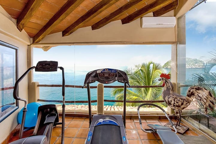 Exercise room with ocean views.