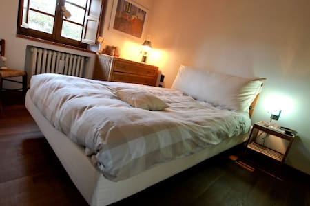Una camera al B&B Podere Sanripoli - Bed & Breakfast