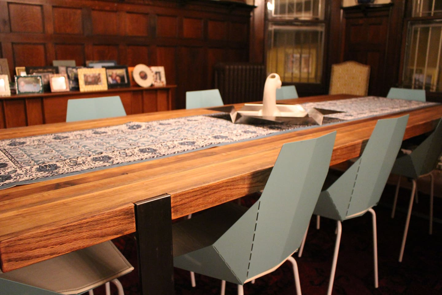 The dining room table seats 10. We furnished the house with modern & industrial pieces to offset the traditional built-in woodwork.