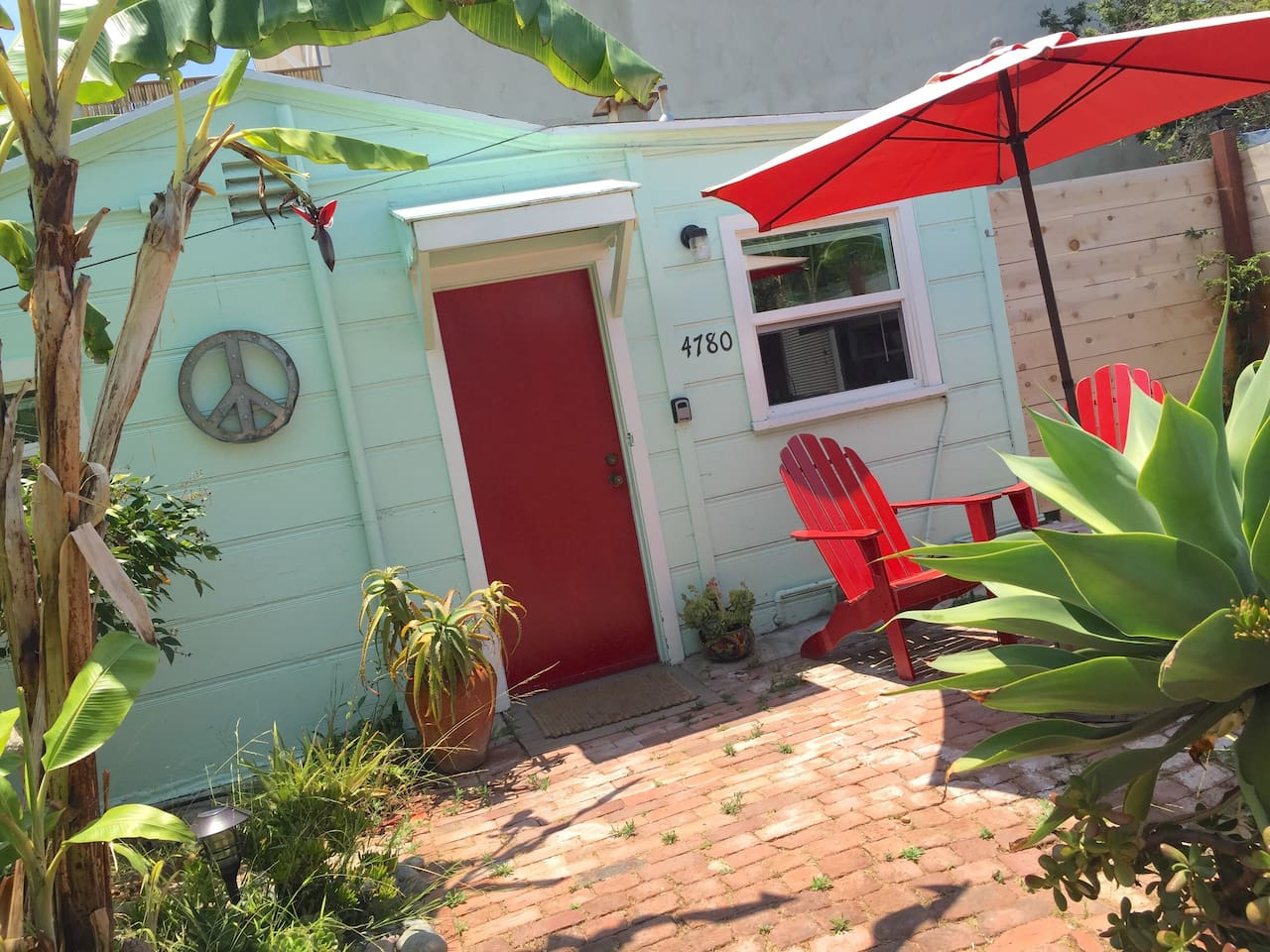 """Soulful beach cottages like this from the 1950s are a rare gem these days. It is a """"tiny house"""" experience from another era that you will love!"""
