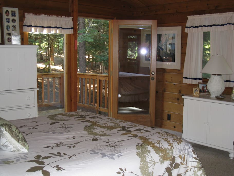 Large queen bedroom with private door to rear deck and spa.