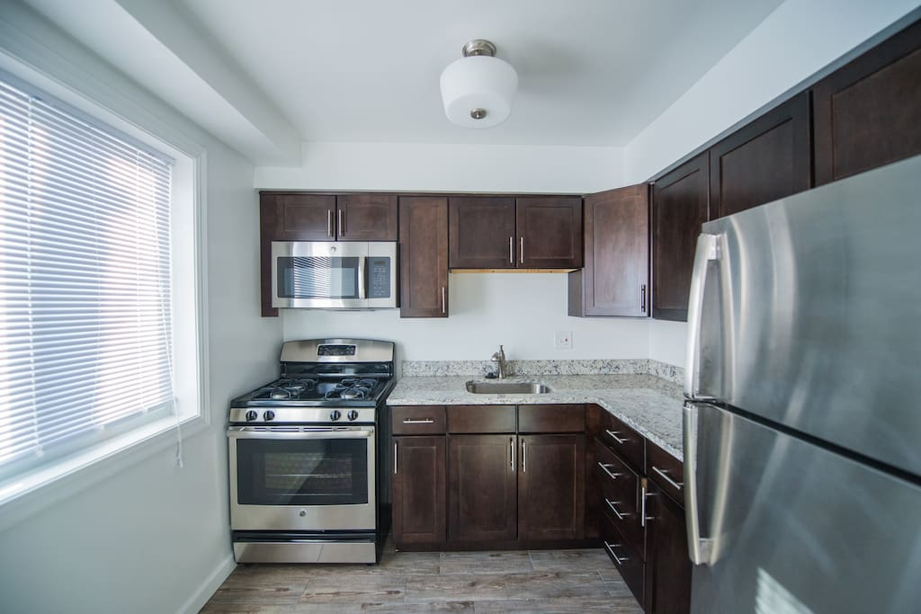 nicely remodeled kitchen with stainless steel appliances
