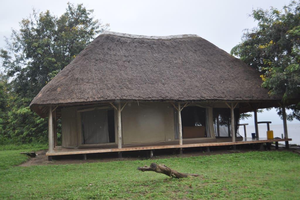 Tented cabin facing the lake.