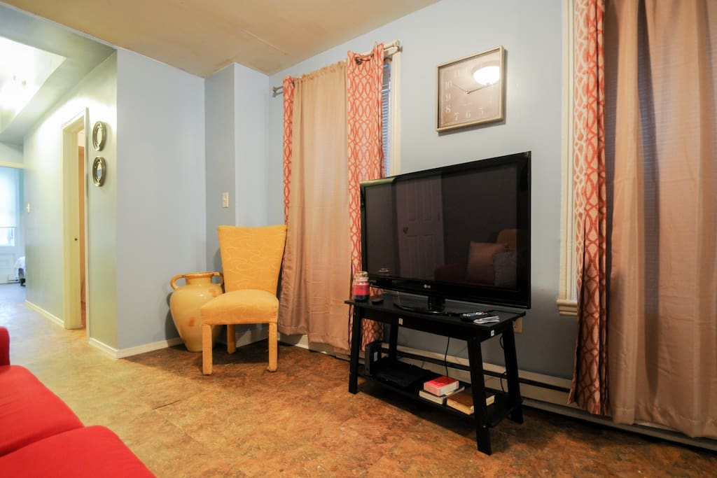 Watch your games, movies, videos, or just lounge at the living room area