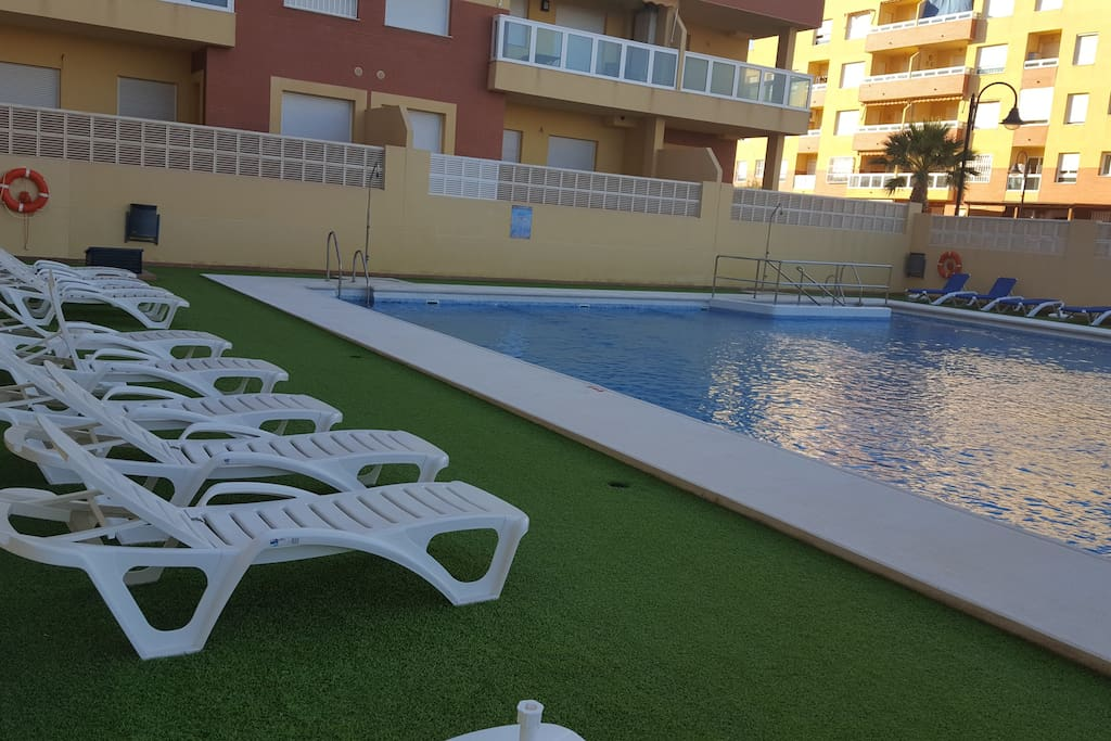 Swimming pool with comfortable chairs.
