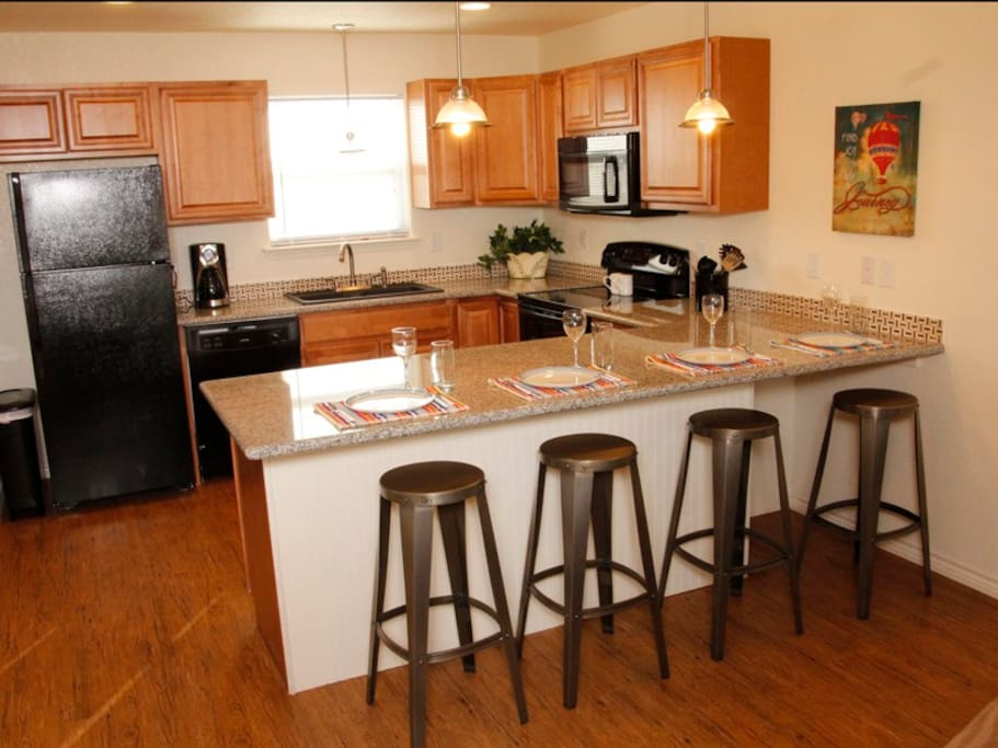 Beautiful kitchen with granite counter tops.