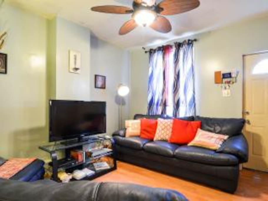 """Nice living room with 40"""" TV, Cable, Couches and Ceiling fan. The best place to hang out with your friends."""