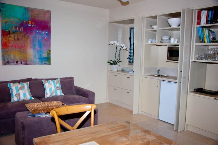 Kitchenette,  comfortable sofa bed, and pull out TV in the sitting room.