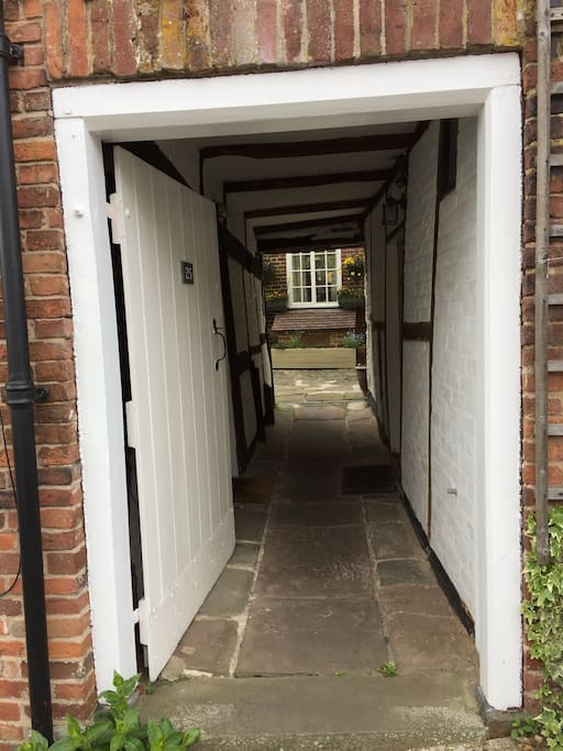Shared passageway leads to three properties and delightful courtyard garden.