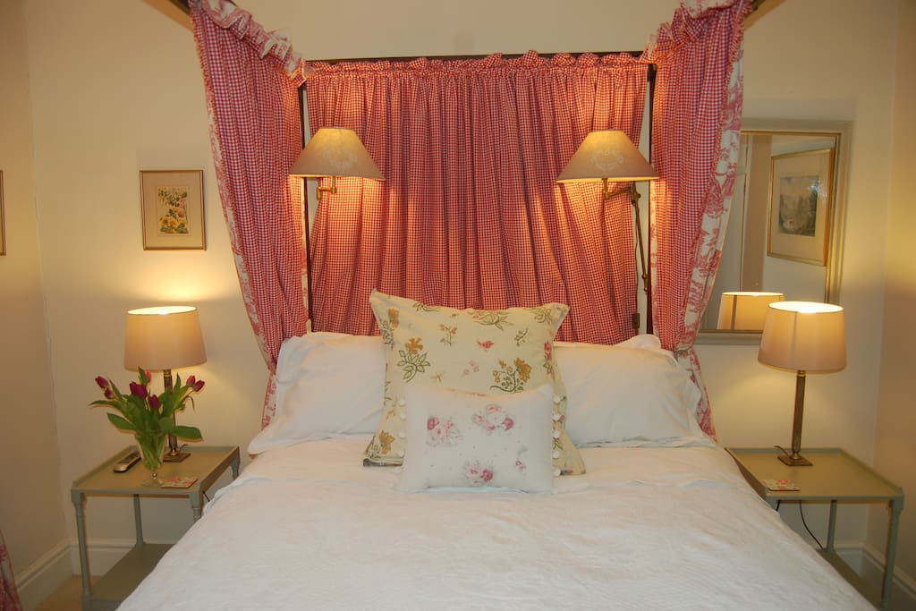 Antique four poster with duck down duvet