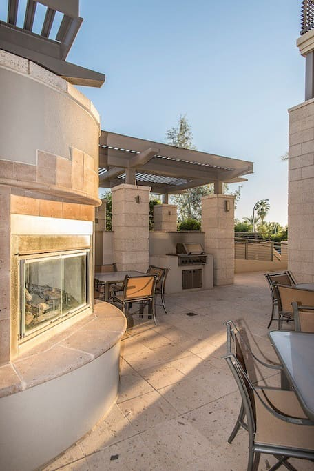 Outdoor grills and gas fireplaces next to pool