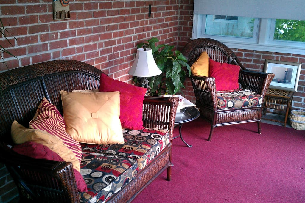 Front porch is a comfy spot to enjoy morning coffee or a glass of wine.
