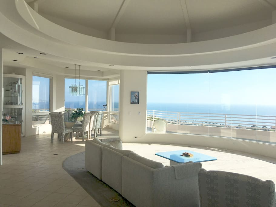 Shared dining room, family room and deck with panoramic views.  This angle is from the living room.