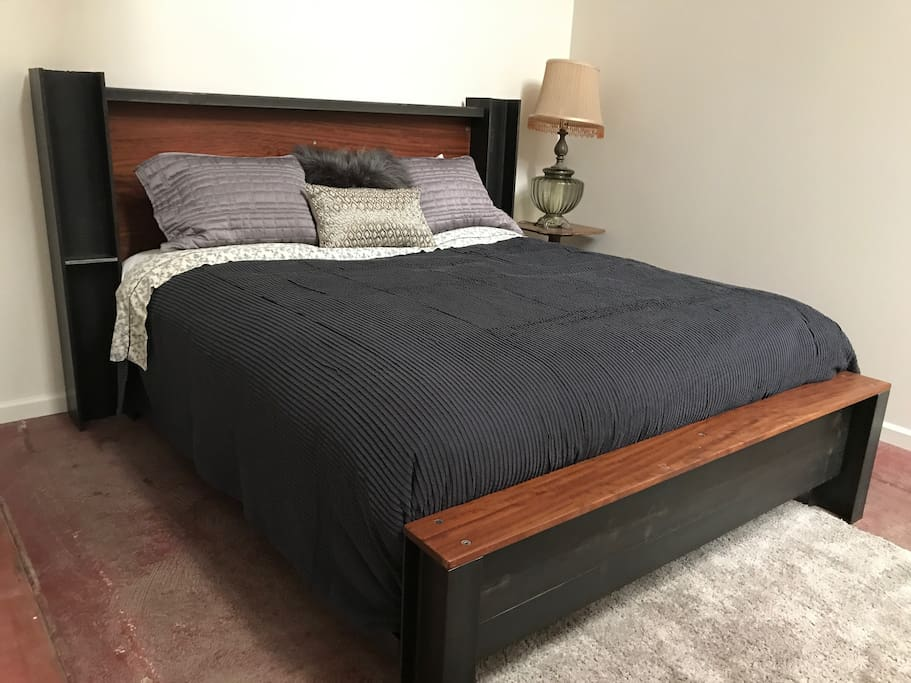 Plush CA King bed in shared room with queen bed