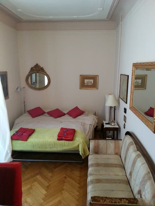 Your super-comfortable double-sofa bed (open) nearby the beatiful bright terrace!