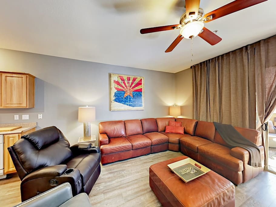 """Gather in the comfy living room for a movie night on the 65"""" flat screen TV."""