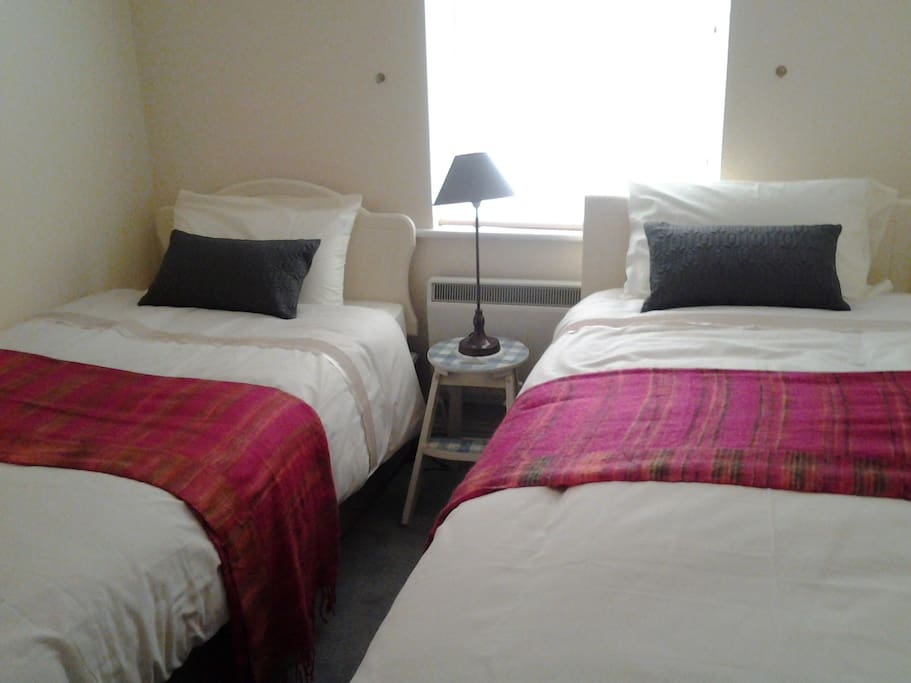 2 single beds in room
