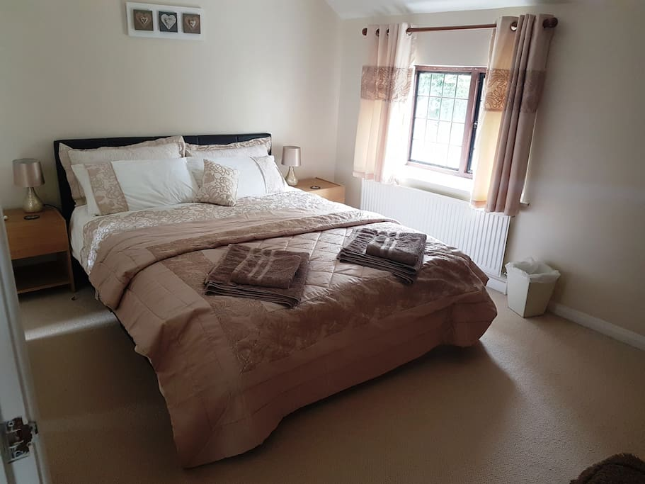 Bedroom with king sized bed and en suite.