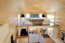 Main sleeping loft with Queen Tuft & Needle mattress and luxurious Pima Cotton linens.