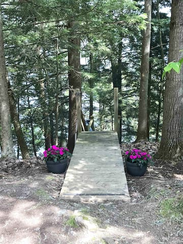 Image shows entrance to staircase to cottage from the parking area.
