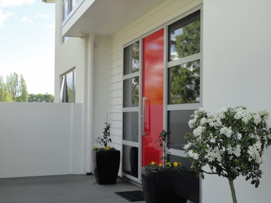 A private and secure entrance into this modern executive townhouse