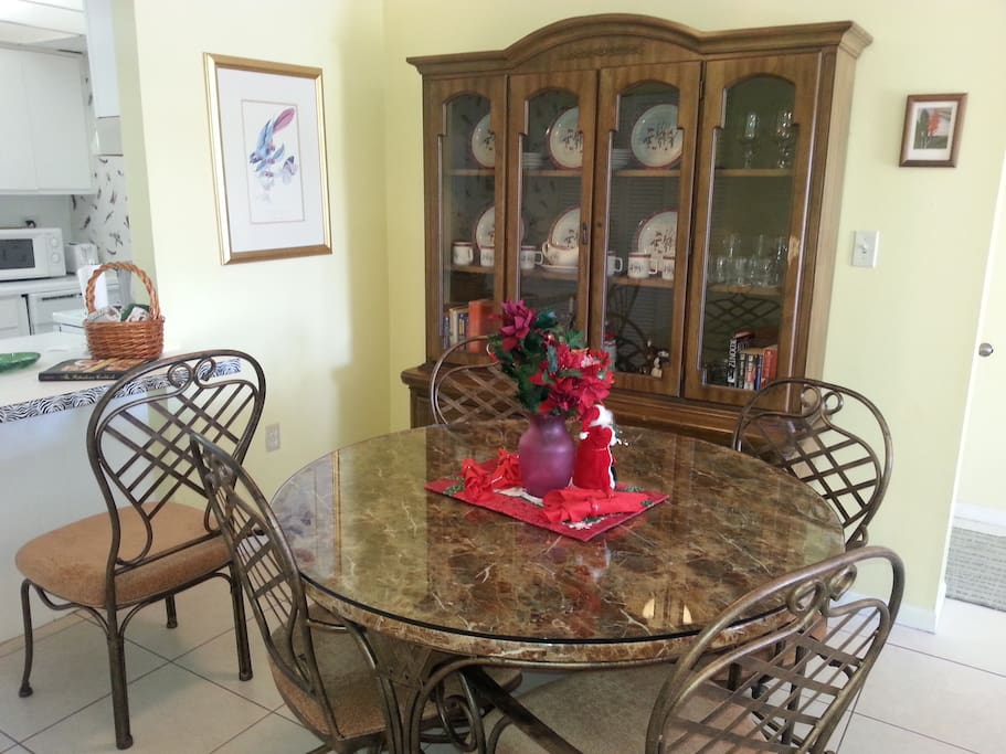 Luxury dining room. Marbke and glass topp table, comfortable swivel seats