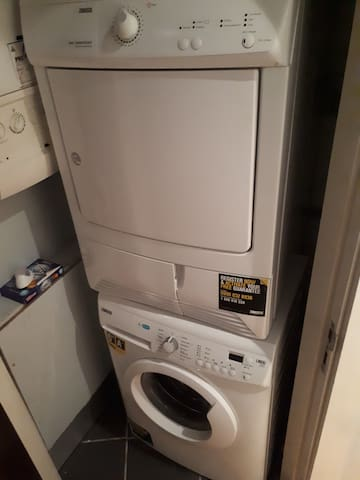 UTILITY AREA contains a washing machine and a tumble dryer. There is also a hanging line , iron and ironing board.