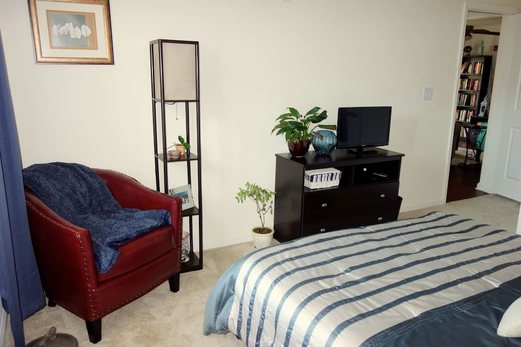 In the guest room, you have your own reading chair and lamp, walk in closet, and flat screen TV with a Smart DVD player so you can either watch a movie from our collection or stream videos. We'll also give you access to our Netflix account!