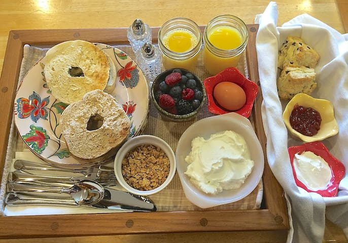 Typical guest breakfast! Greek yogurt, granola, bagels, fruit, home-made scones and more!