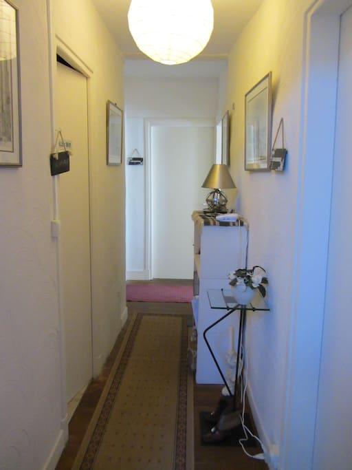 hallway to shared  bathroom