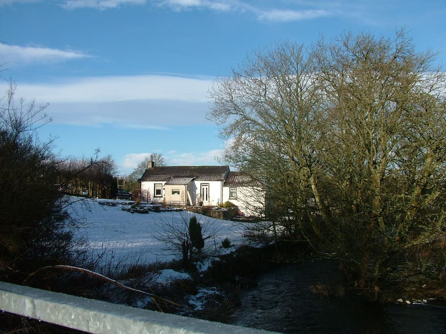 view of cottage from waterfall