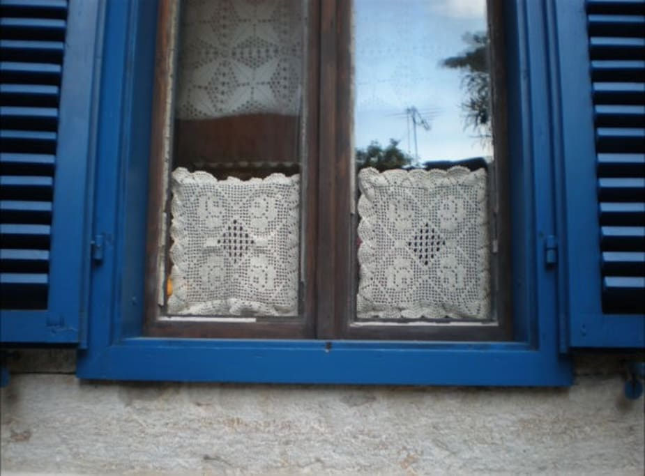 One of the kitchen windows with traditional Croatian lace...