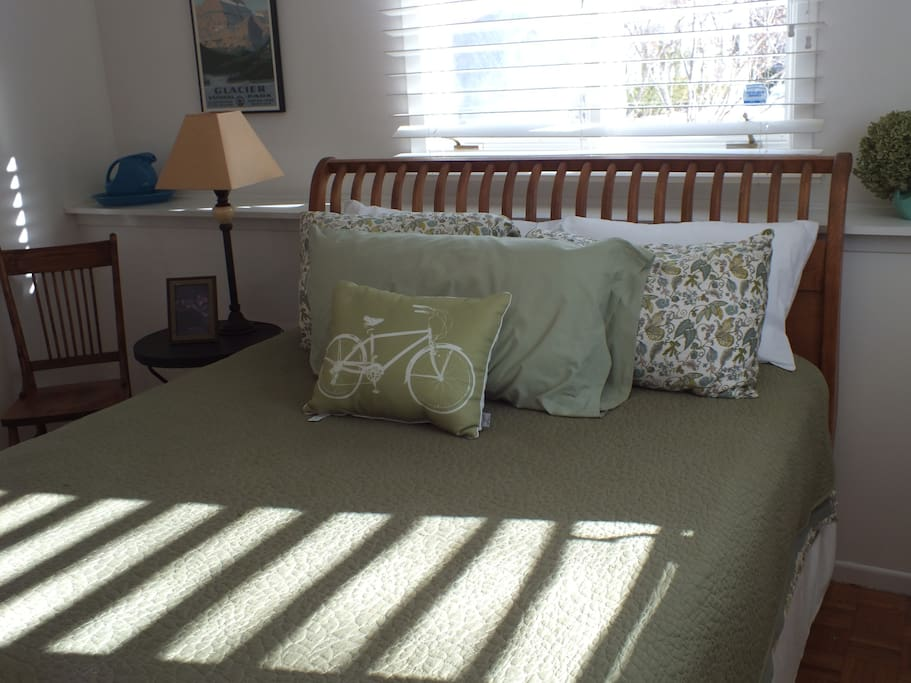 Green room has a comfy Queen bed, nightstands, dresser and large closet.