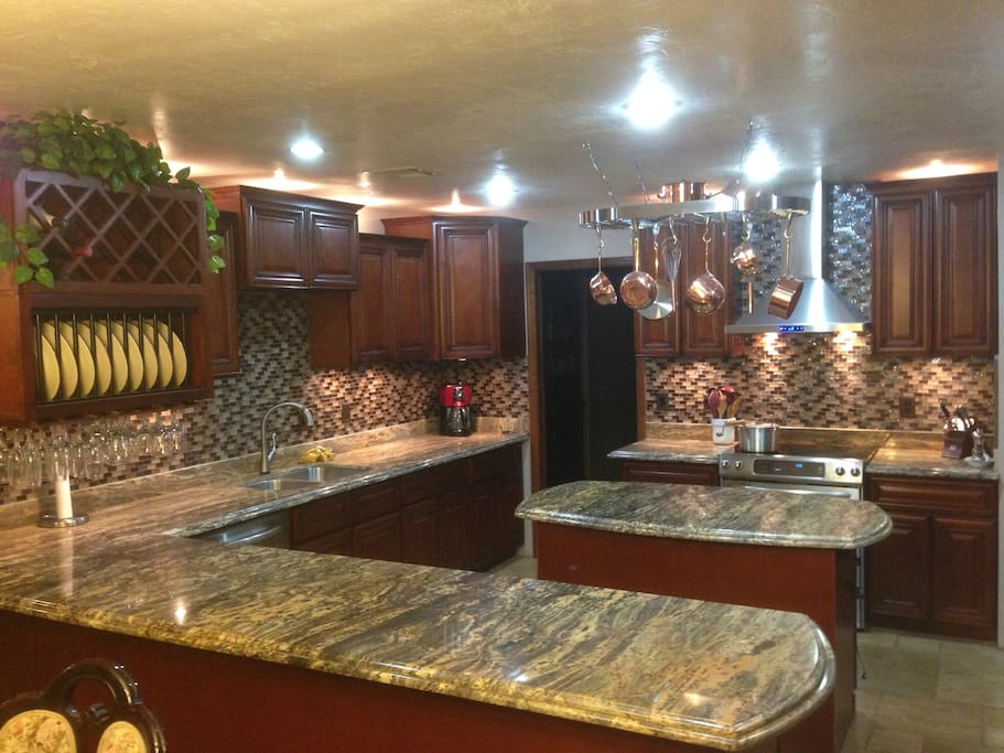 Luxury kitchen with new appliances and granite.