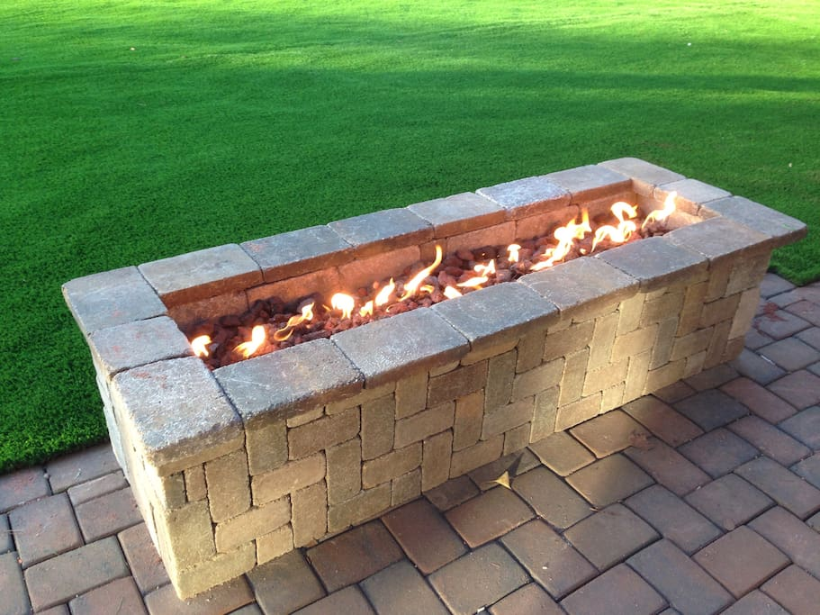 Fire pit in the back yard to enjoys evenings.