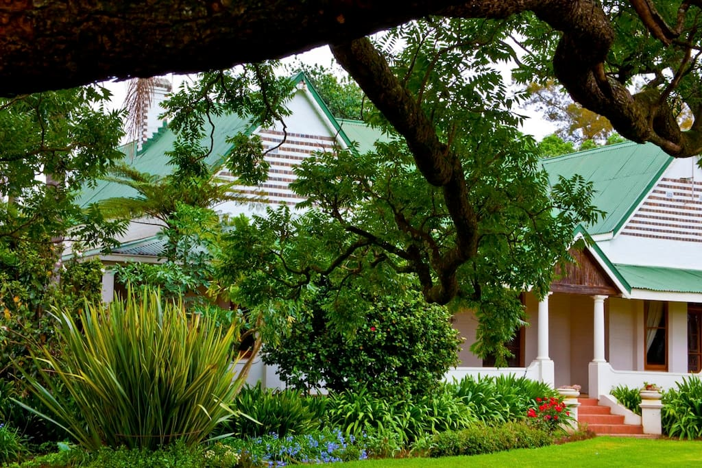 The architecture of over a 100 years ago is surrounded by a breathtaking garden...
