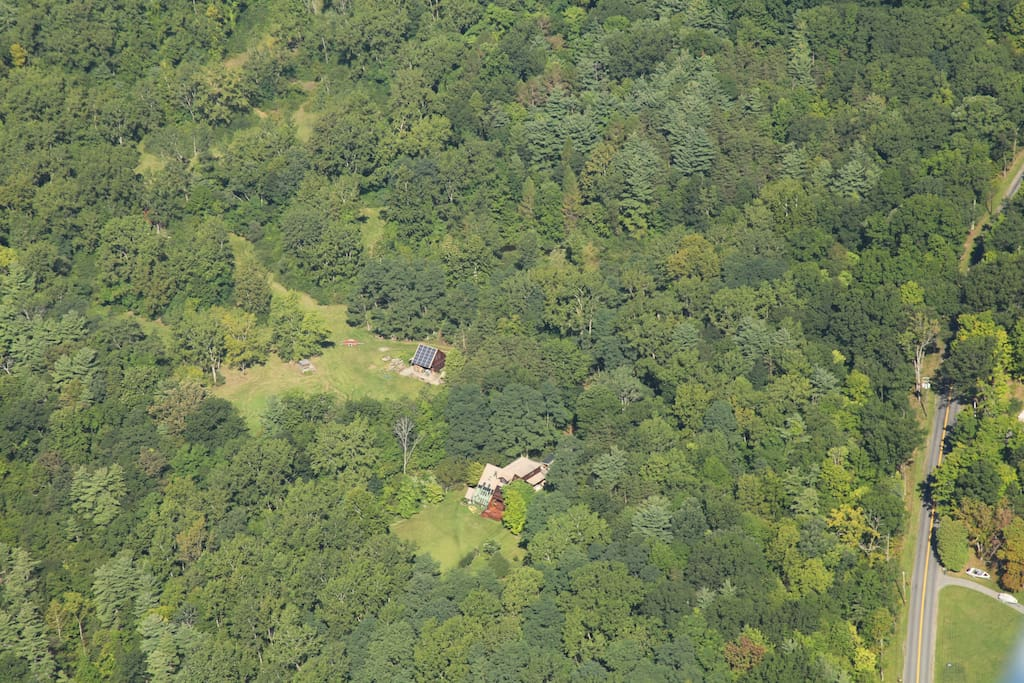 Aerial shot of the property! House in the middle of ~36 acres of forest.