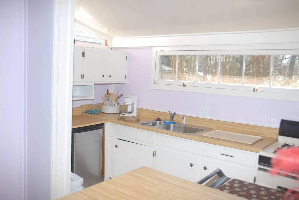 Galley kitchen with stove & oven