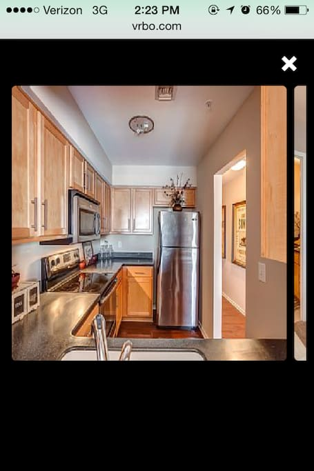 awesome kitchen with stainless steel appliances and everything you need to cook